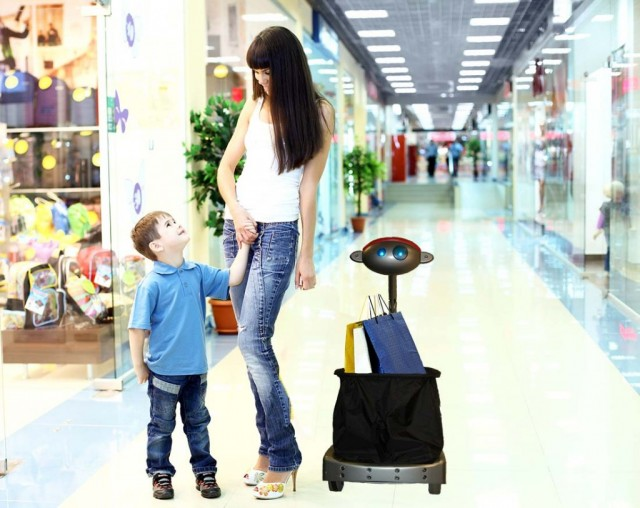Budgee the Robot shopping with mom and son