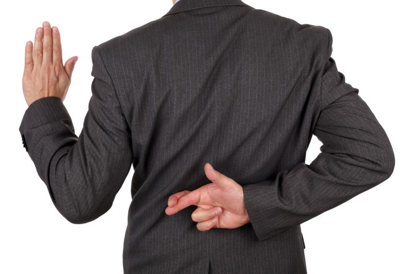 man crossing fingers behind back