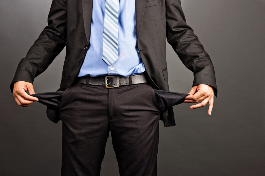 man holding out empty pockets