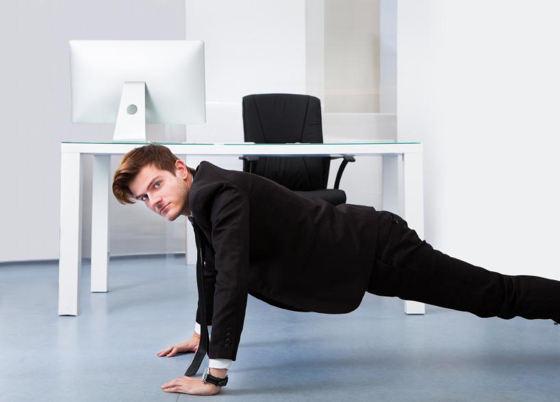 Man doing push-ups at the office