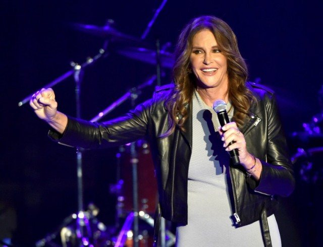 Caitlyn Jenner holding a microphone