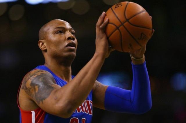 Caron Butler shooting a basketball into a hoop.