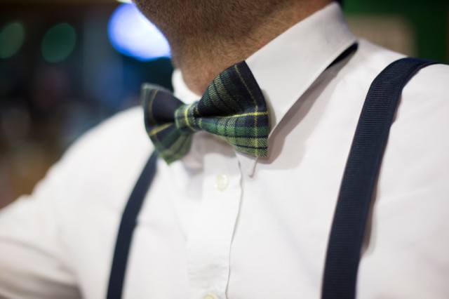 Man wearing a bow tie and suspenders