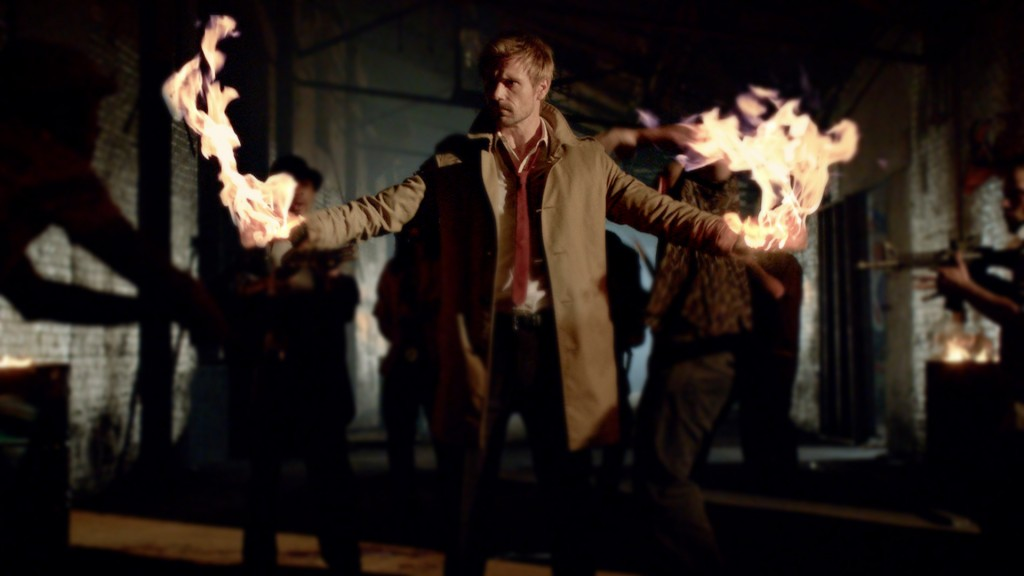 Constantine with his arms out, and flames coming ut of both hands