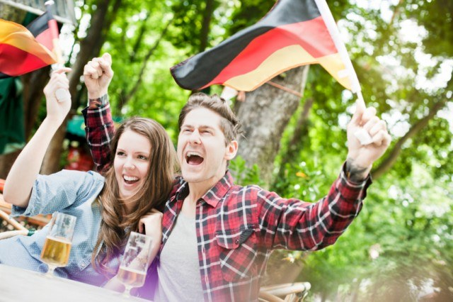 couple holding a German flag
