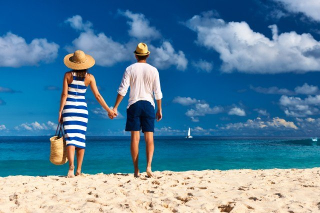 Couple in lasting relationship holding hands at the beach