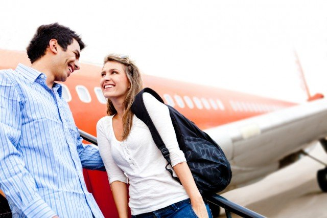 Couple traveling by airplane