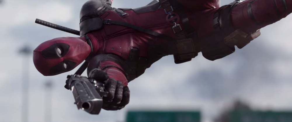 Deadpool soaring majestically through the air