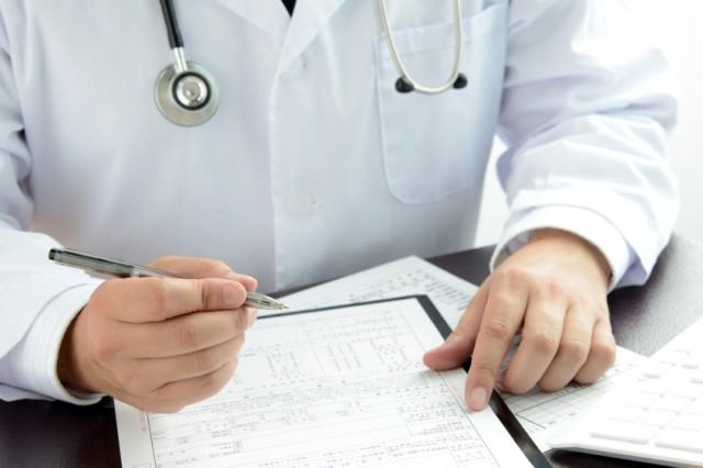 a doctor looking at his notes