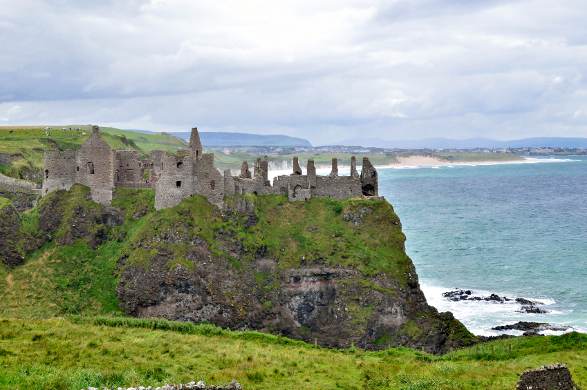 dunluce castle on a holl overlooking the ocean in ireland