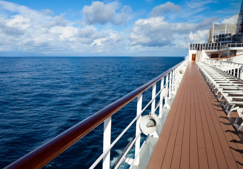 Empty sun loungers on deck of cruise ship, boat, travel