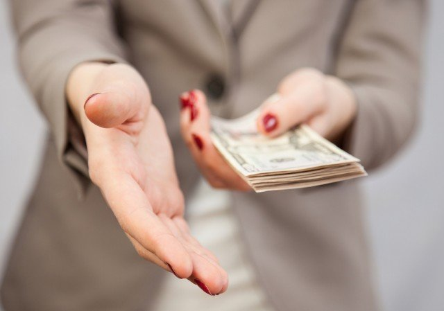 A woman asks for more of your money