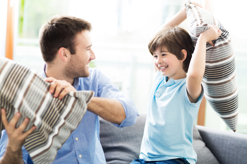 Father and son having pillow fight, dad, family
