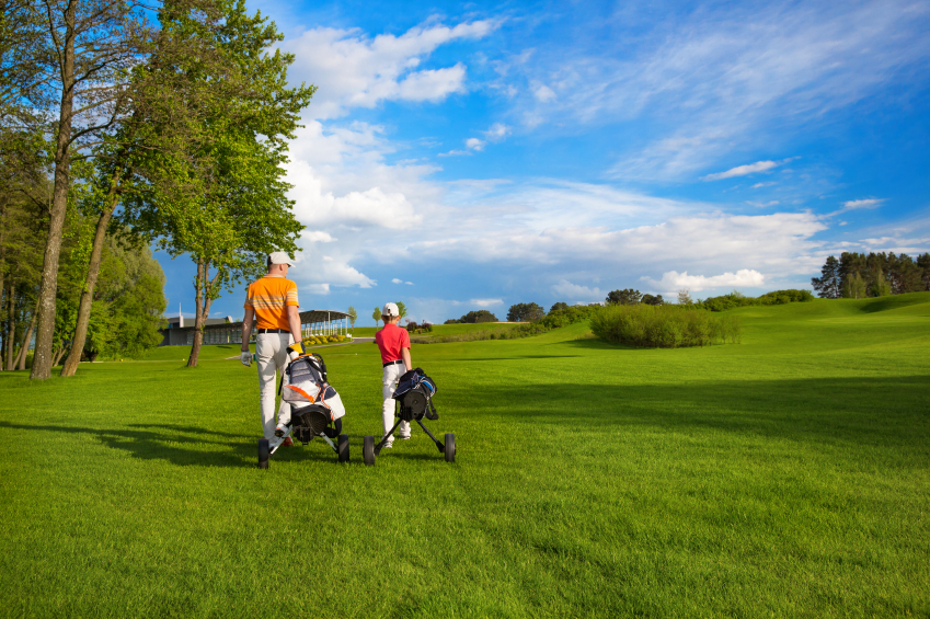 Father with son at golf field