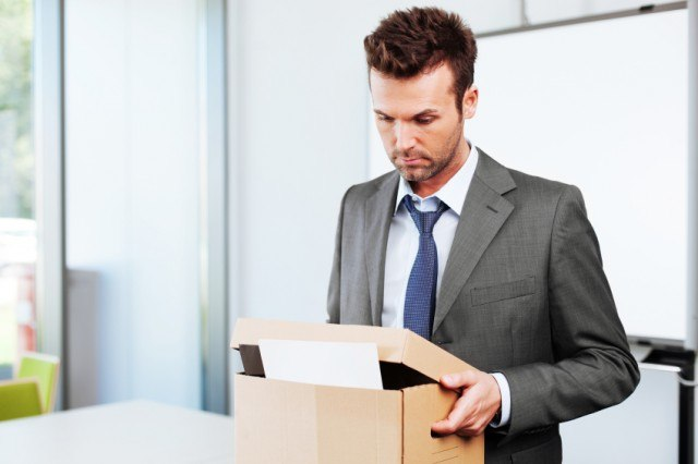 Man packing a box and leaving a job.