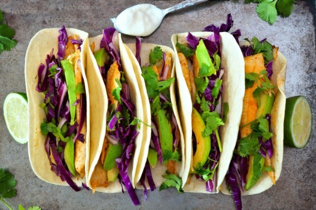 fish tacos with red cabbage slaw and sliced avocado