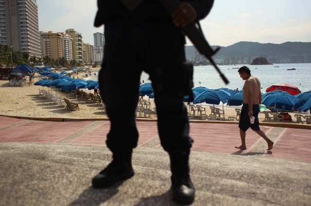 man with gun in Acapulco, Mexico
