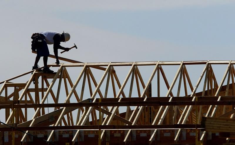 A construction worker hammering away