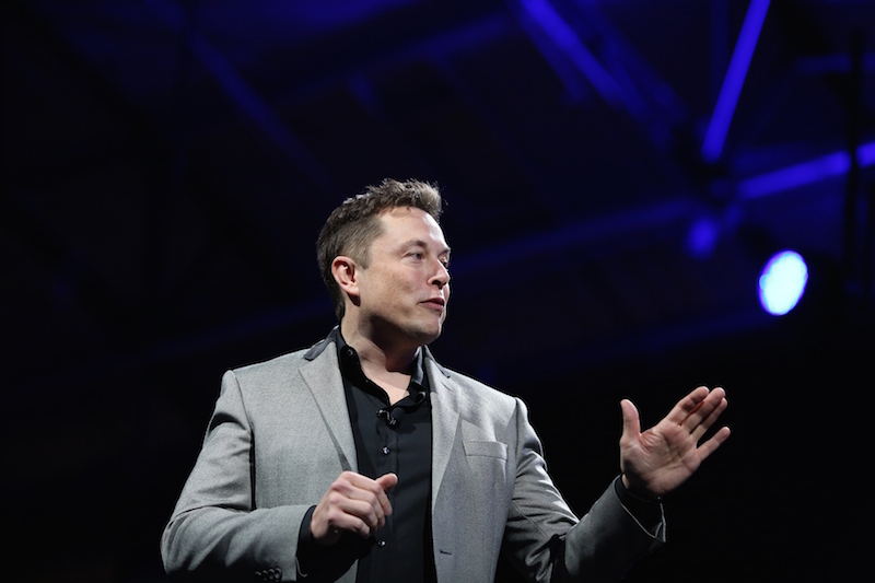 Shot of Elon Musk on stage for a Tesla event