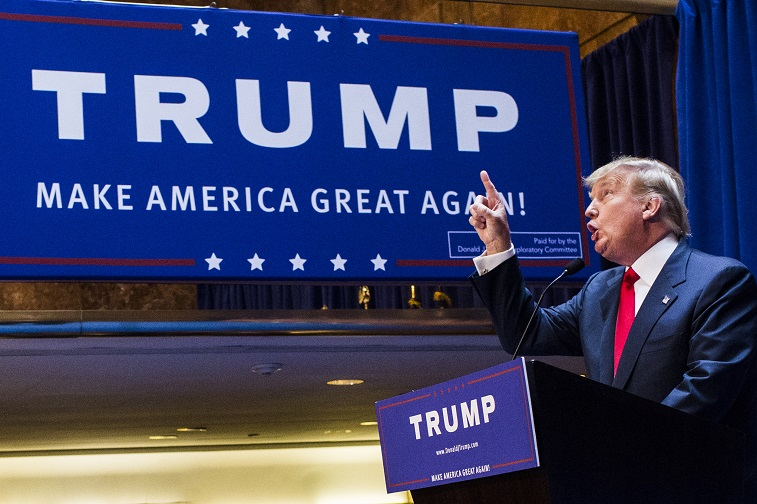 Business mogul Donald Trump points as he gives a speech as he announces his candidacy for the U.S. presidency