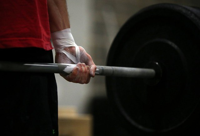 a man weight lifting