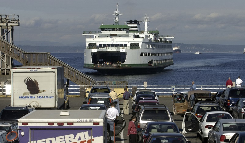 a ferry with cars in front of it