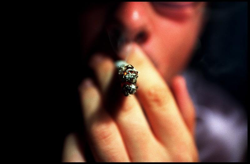 A man smoking marijuana