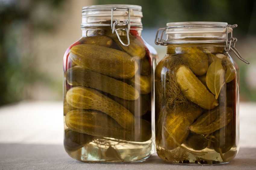 Glass jars of homemade canned cucumbers, pickles