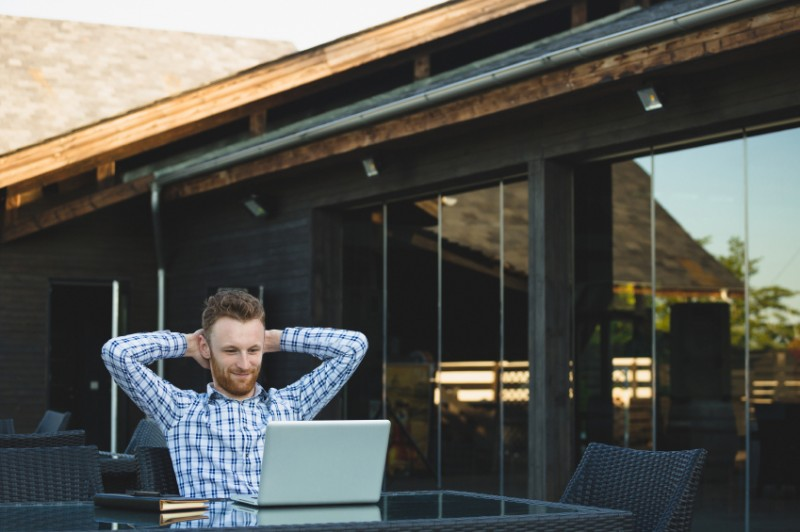 Handsome businessman working with laptop, outside