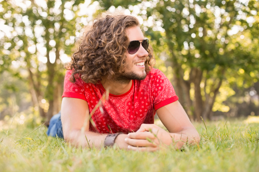 happy man with curly hair