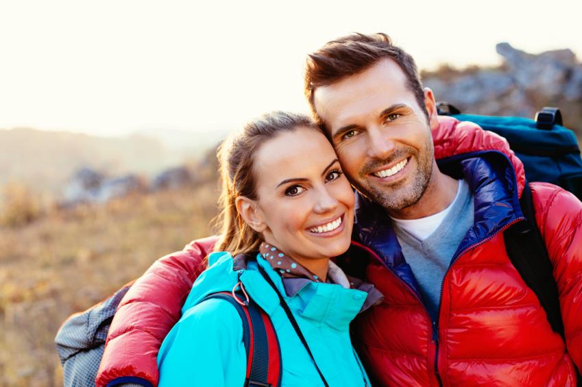 couple exercising while hiking