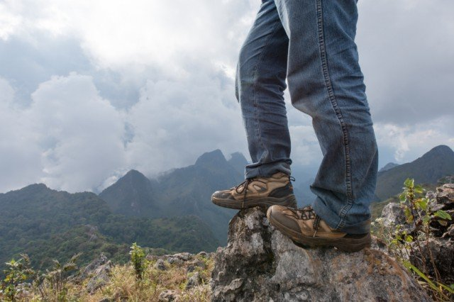 legs of a hiker standing on a rock in the Tennessee mountains