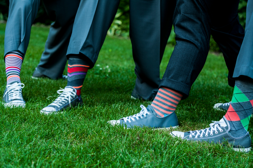 men wearing colorful socks with sneakers