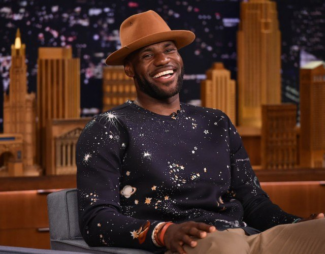 LeBron James in a dark sweater and brown top hat