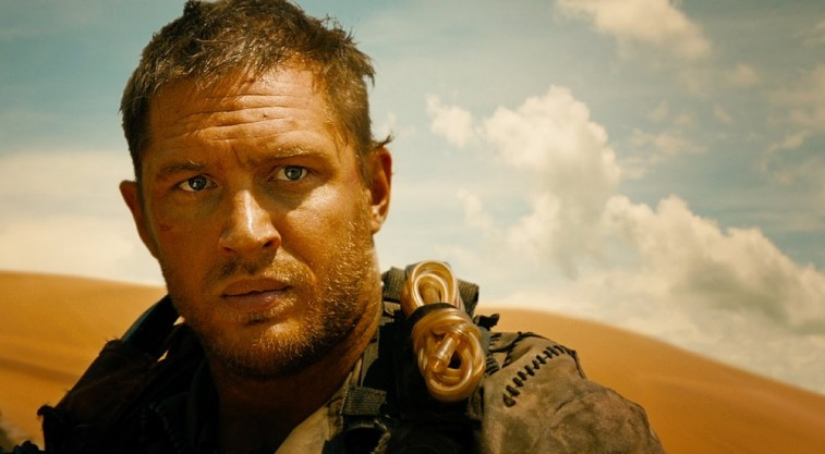 Tom Hardy looks ahead and is in a desert in Mad Max: Fury Road.
