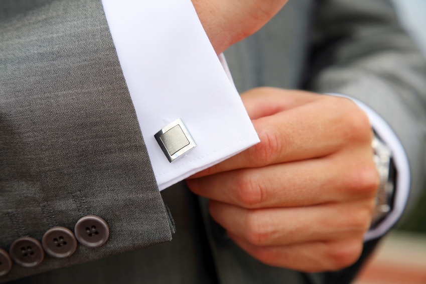Man fastening his cufflinks