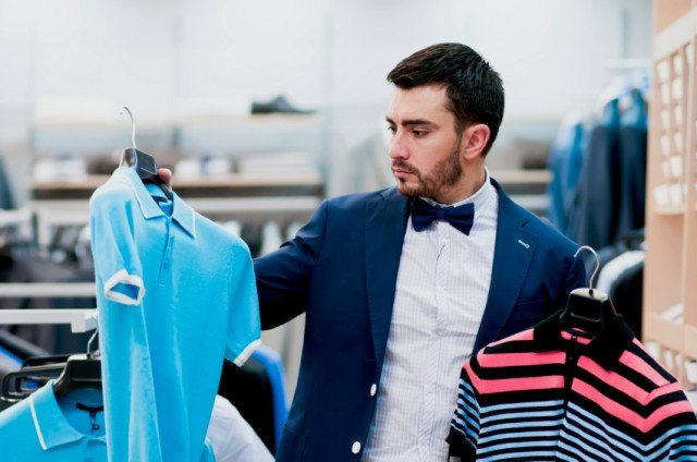 man decides between two shirts
