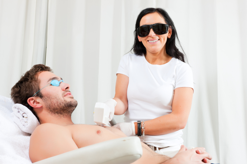 Man in cosmetic salon receiving waxing, grooming, shaving