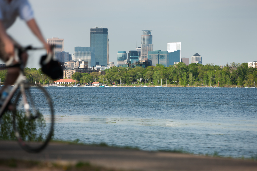 A cyclist finds a way to save money by commuting via bicycle near downtown Minneapolis