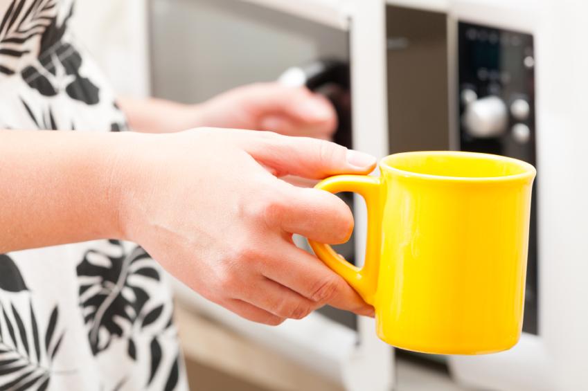 A woman holds a mug