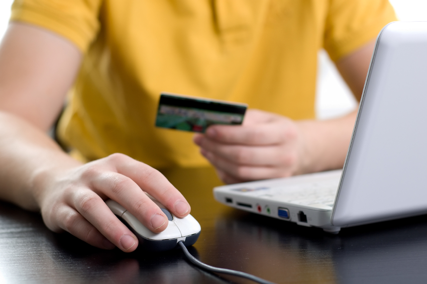 man checking credit card use online
