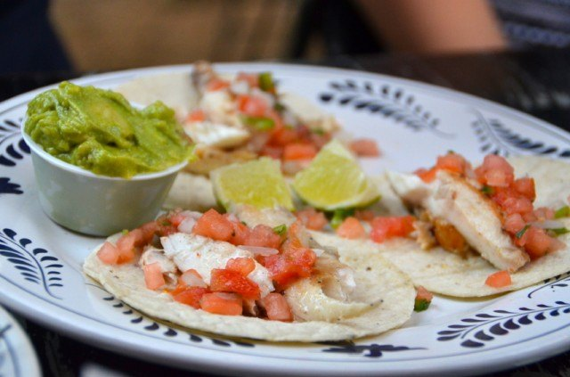 Tacos on a plate with guacamole