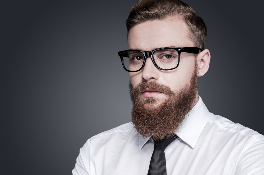 a confident man with a beard