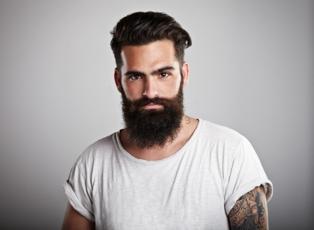 Portrait of tattooed bearded man wearing t-shirt, beard
