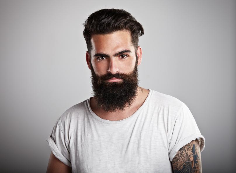 Portrait of tattooed bearded man wearing t-shirt,