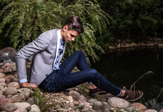 Stylish man wearing selvedge jeans and posing