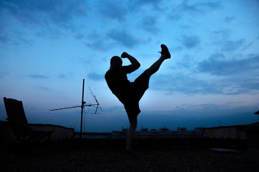 man practicing leg swings