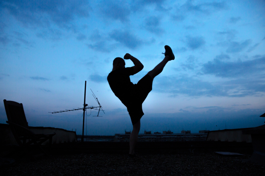 Man doing a high kick