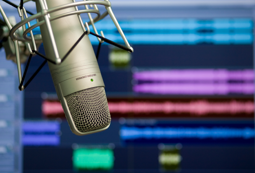 a microphone in front of a recording studio screen