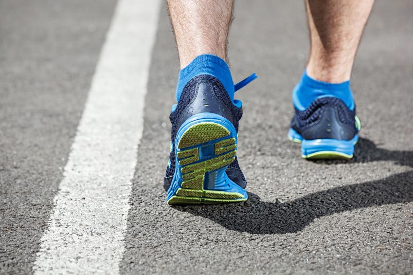 man walking on a track